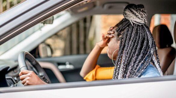 Black Woman Driving a Car